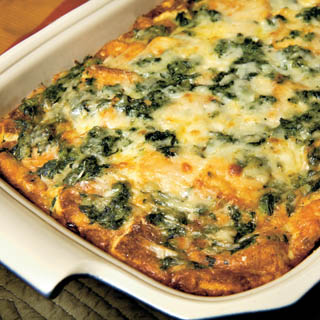 With Swiss cheese, onions and spinach, our oven-fresh breakfast strata ...