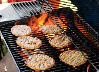 beef burgers on the grill