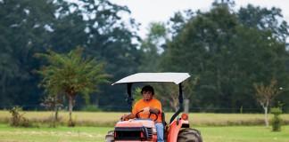 Alabama FFA student on tractor