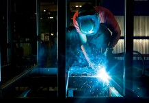 Foundations for Growth- man welding steel